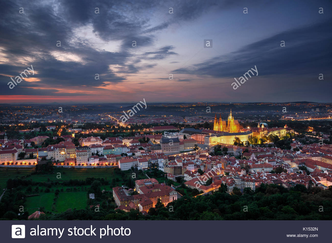 Aerial view at St. Vitus Cathedral during cloudy sunset, Prague, Czech republic. - Stock Image