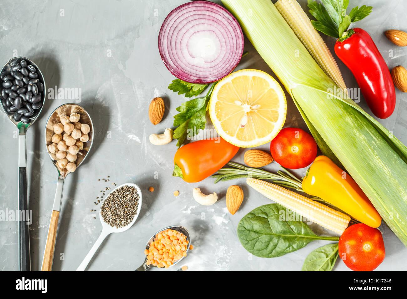 Vegan background. Ingredients for a vegetarian diet. tofu, grains and vegetables. - Stock Image