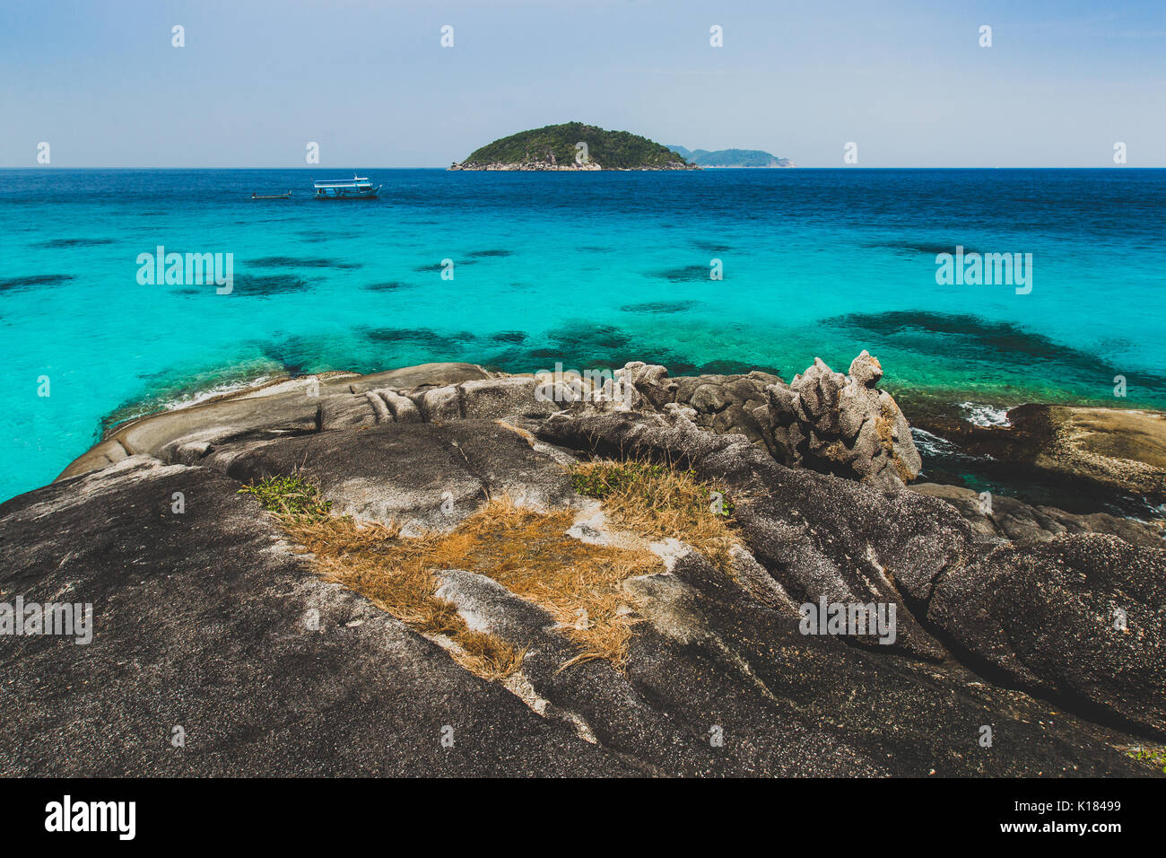 Sea bay with clear emerald water. Idyllic place for snorkelling and diving in Similan - Stock Image