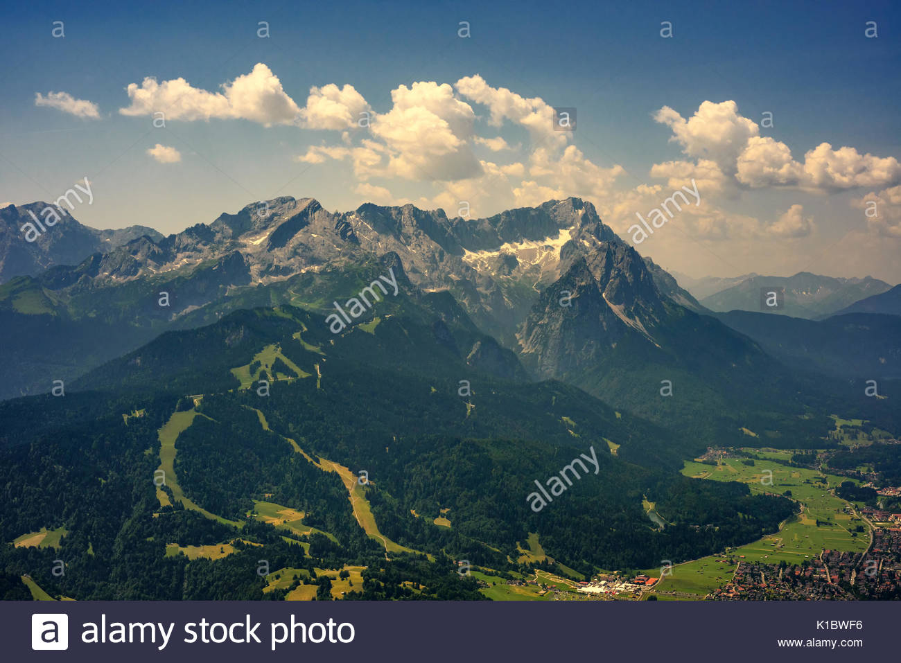 Beautiful view at highest mountain peak Zugspitze and Alpspix with Garmisch Partenkirchen from Wank mountain. Hot - Stock Image