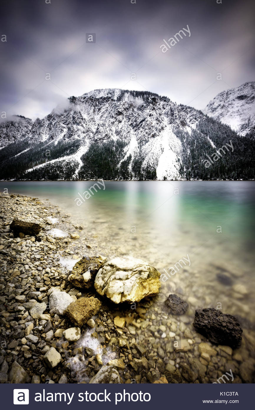 Landscape of Plansee lake and Alps mountains during winter, snowy view, Tyrol, Austria. - Stock Image