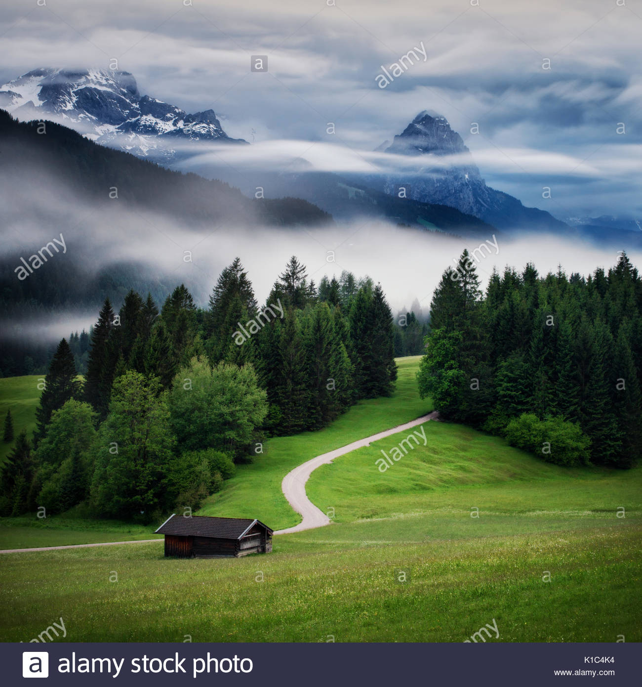 Wetterstein mountain during autumn rainy day with evening fog, Bavarian Alps, Bavaria, Germany. - Stock Image