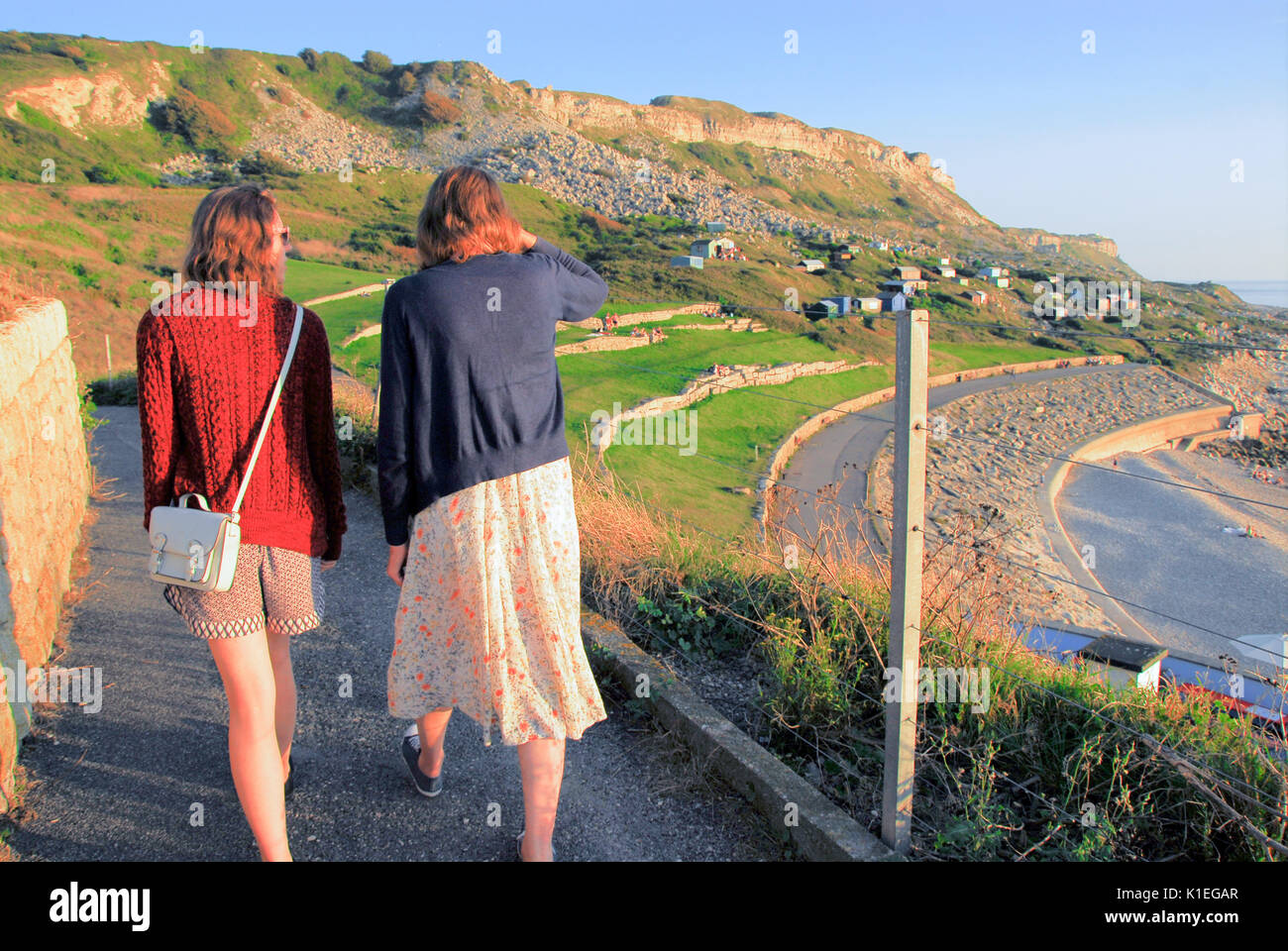 Portland, UK. 27th Aug, 2017. People on Chesil Beach were still enjoying a humid 24 degrees centigrade at 8 p.m. - Stock Image