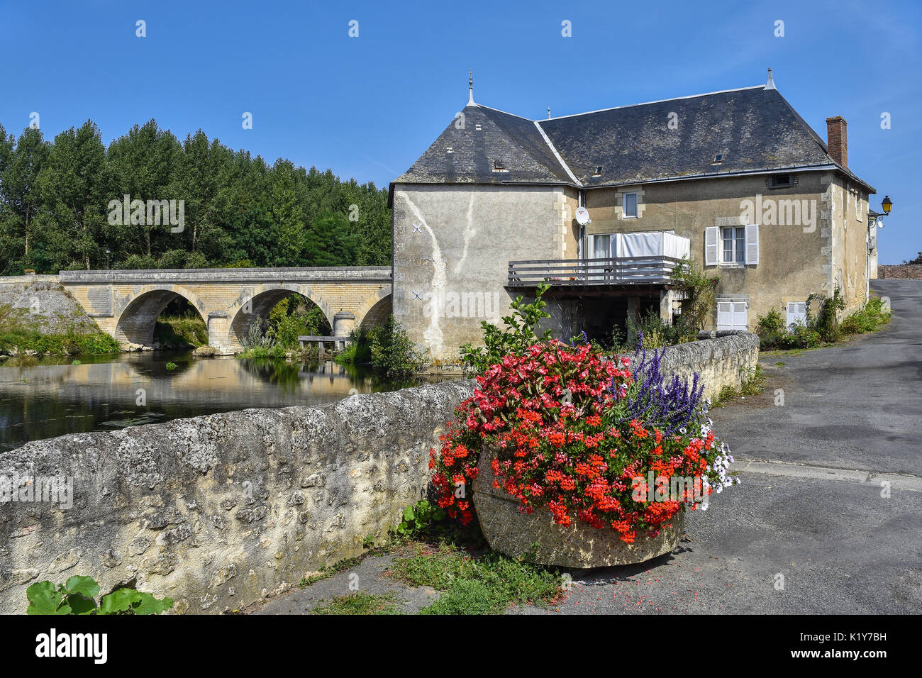 Watermill and bridge across river Gartempe, Saint-Pierre-de-Maillé, Vienne, France. - Stock Image