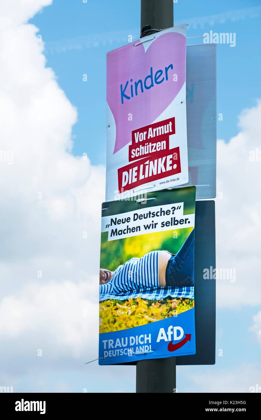 Berlin, Germany. 28th August 2017. Party political posters for far-left party, Die Linke ( The Left)  (top) with - Stock Image