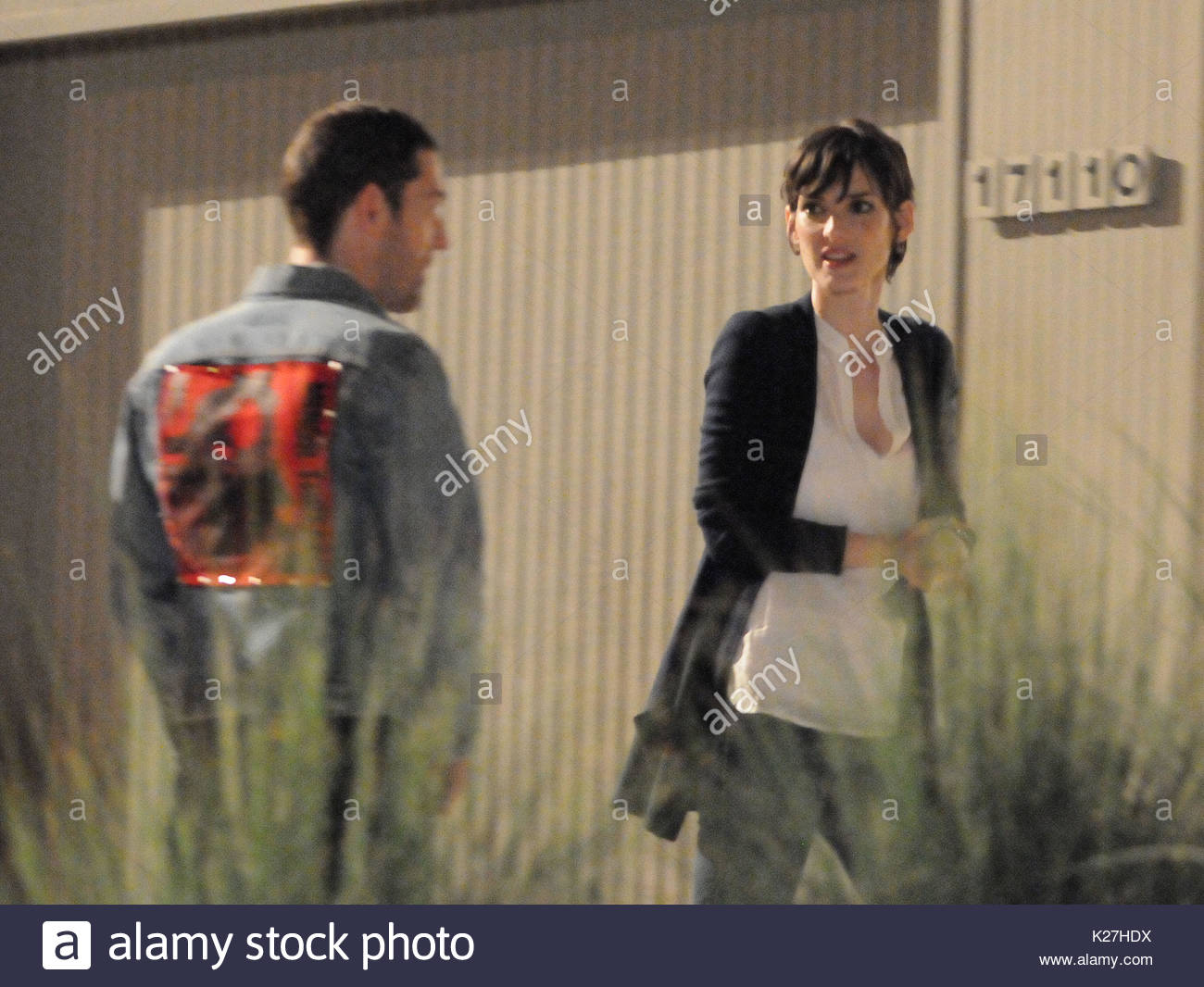 Mark Polish and Winona Ryder. Winona Ryder and Mark Polish shooting a night scene on their new movie 'Stay Cool'. - Stock Image
