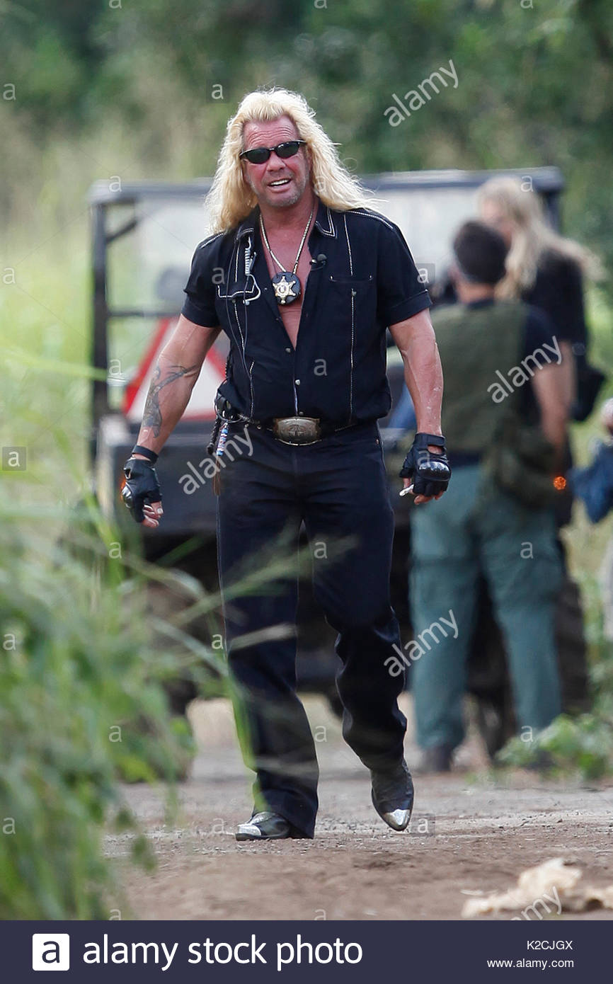 Atv hunting stock photos atv hunting stock images alamy for Duane chapman dog the bounty hunter