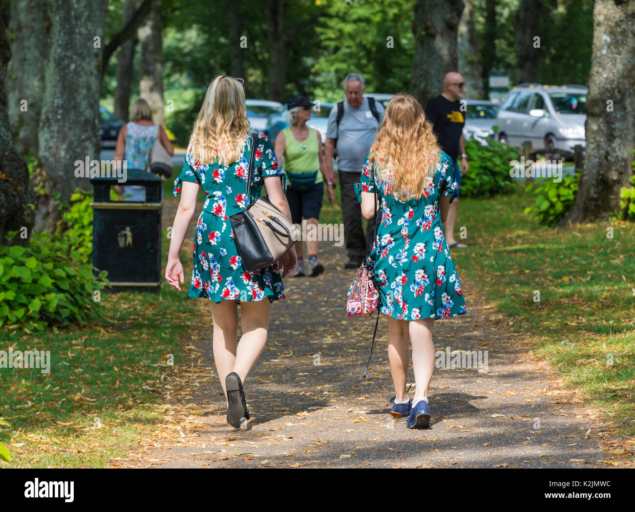 pair-of-young-women-dressed-in-identical