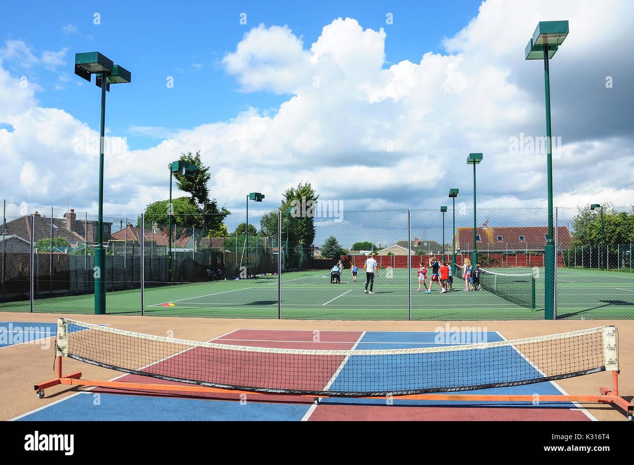 Kids summer tennis camp at Fordbridge Park, Ashford, Surrey, England, United Kingdom - Stock Image