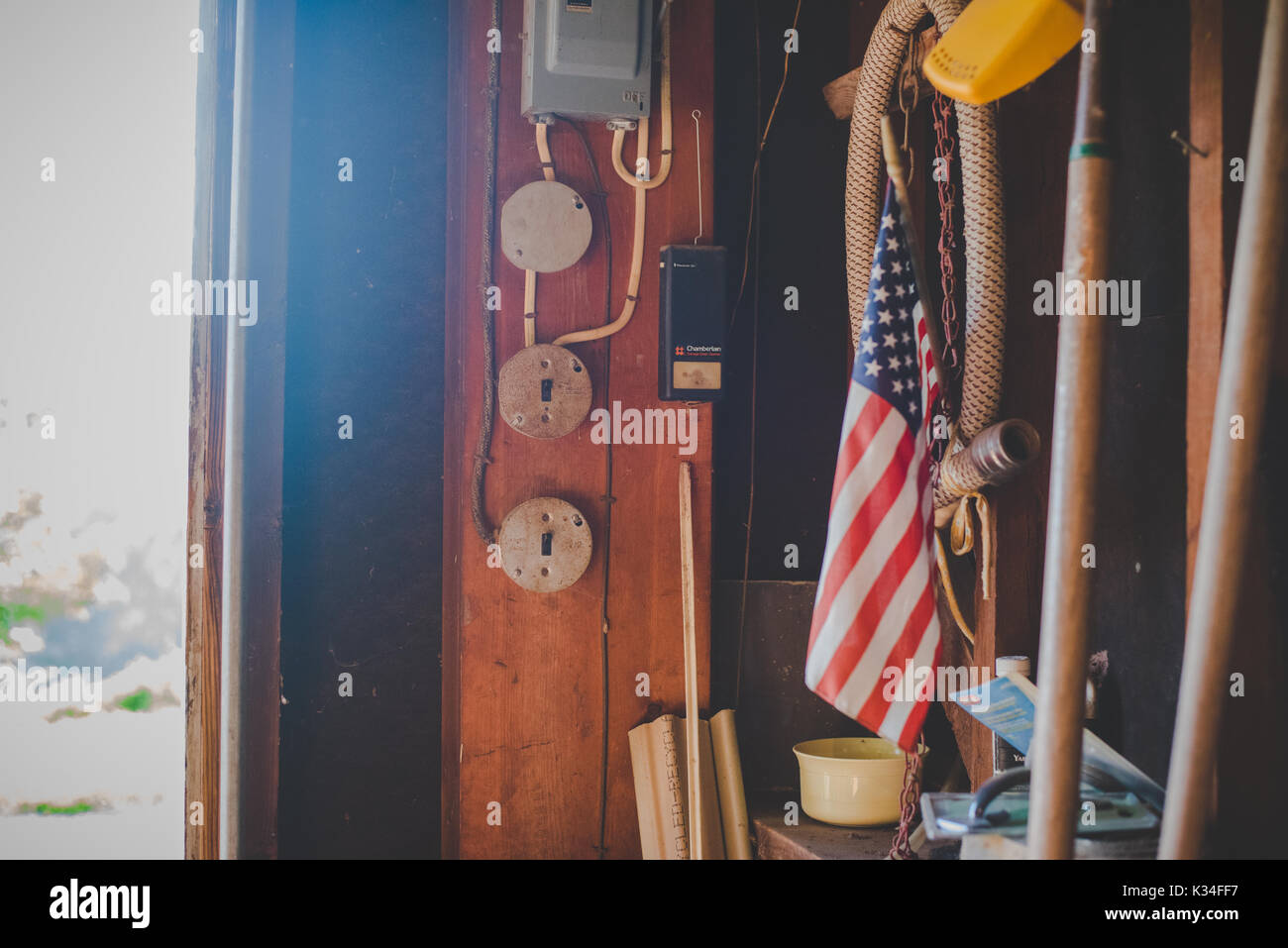 An American flag in a dusty old garage. - Stock Image