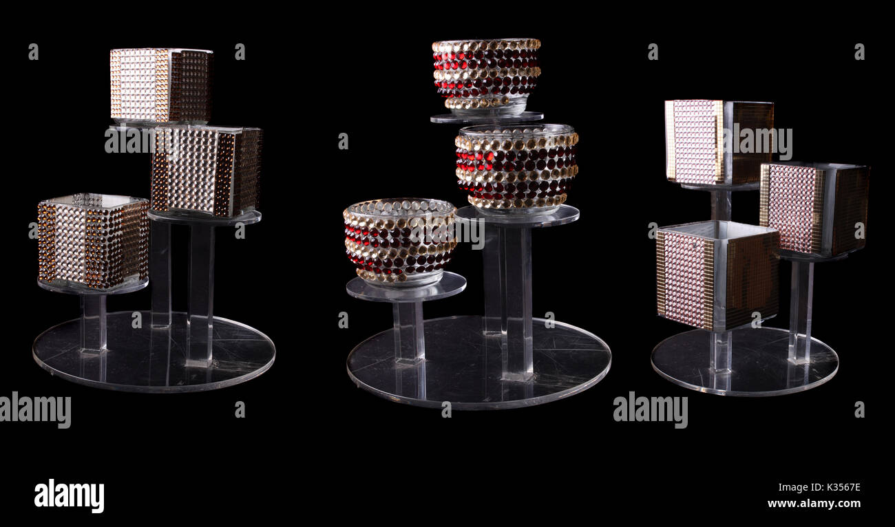 A set of designer candle stands with beautiful different designs studded with decorative stones. - Stock Image