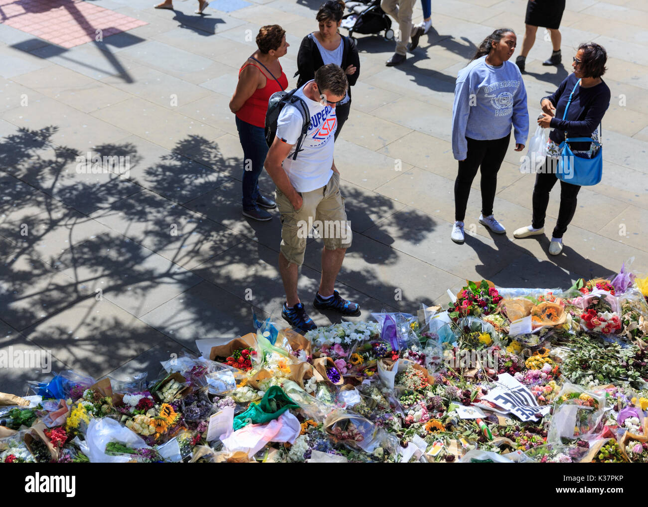People look at the sea of flowers, tributes and condolences at vigil near the scene of the 2017 London Bridge and - Stock Image
