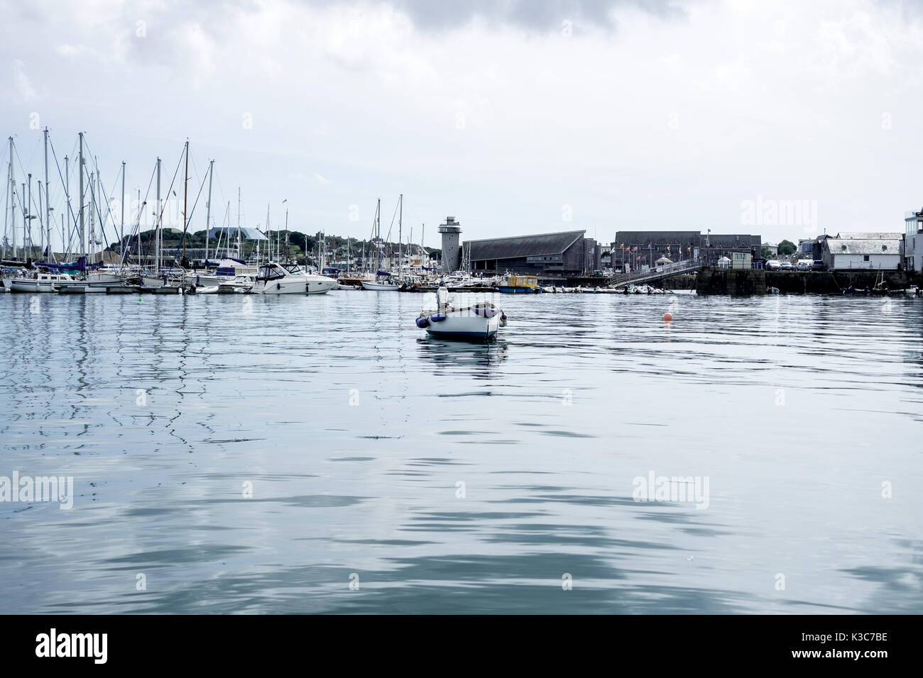View of Falmouth Haven, a deep water mooring and leisure boat marina, on a clear and calm weather day. Stock Photo