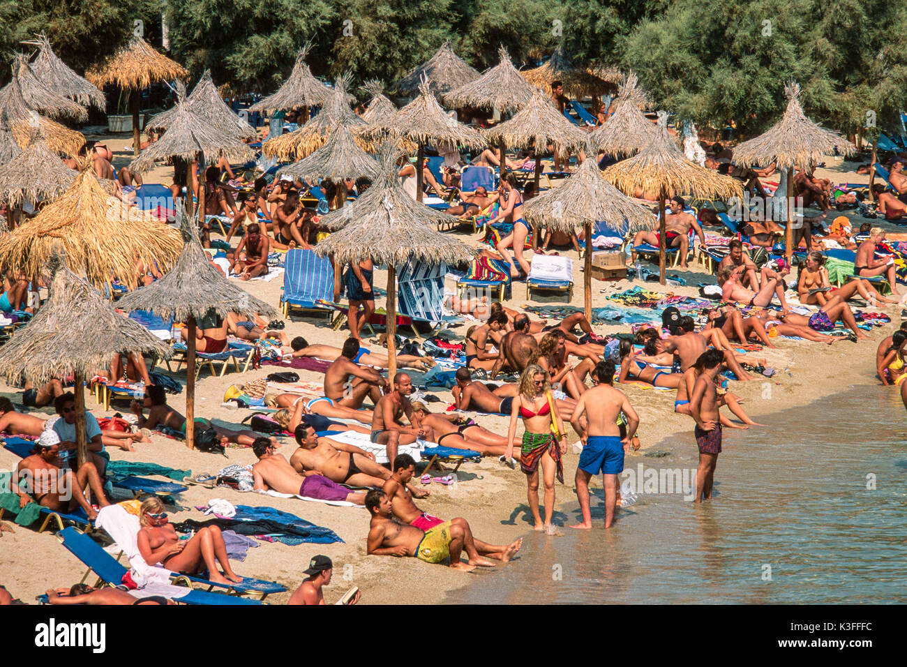 Congested holiday beach, Mykonos, Greece - Stock Image