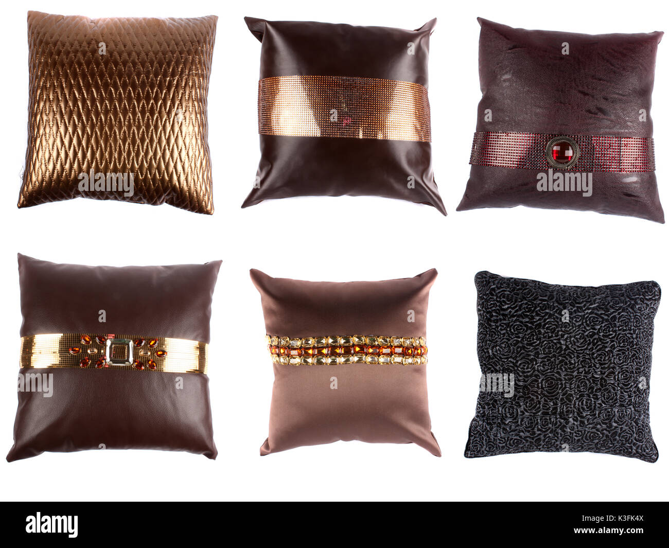 A set of beautiful designer pillows with inticrate designs, on white studio background - Stock Image