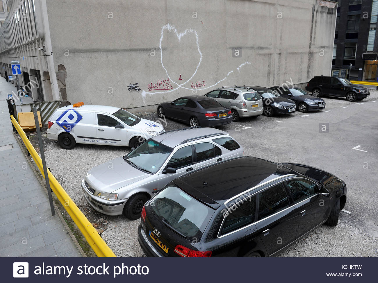 Graffiti on car park wall stock photos graffiti on car for Wall street motor cars