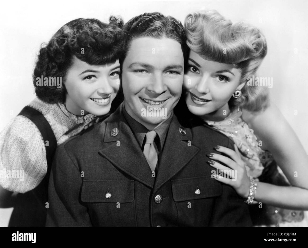 DOUGHBOYS IN IRELAND [US 1943]  [L-R] JEFF DONNELL as Molly Callahan,  KENNY BAKER as Danny O'Keefe,  LYNN MERRICK - Stock Image