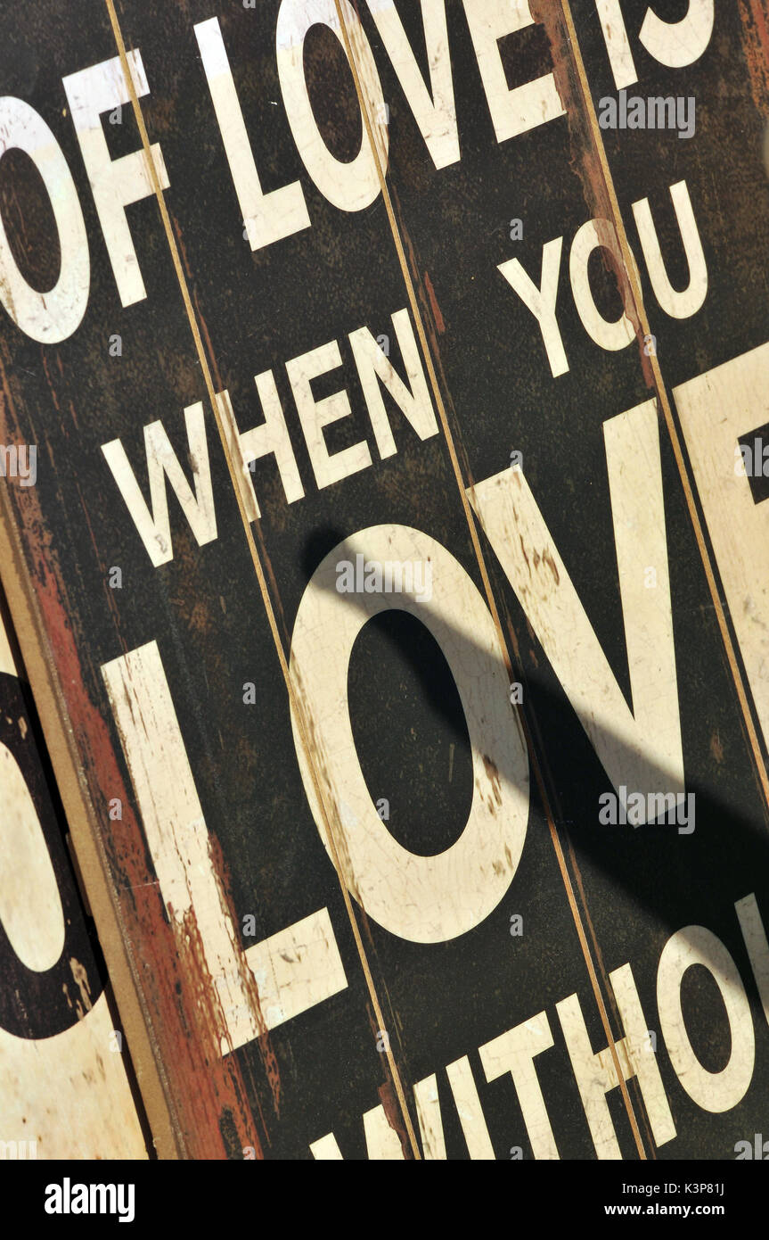 Love poster advertising love relationships loving somebody in love with partners wall hanging placard poster love - Stock Image