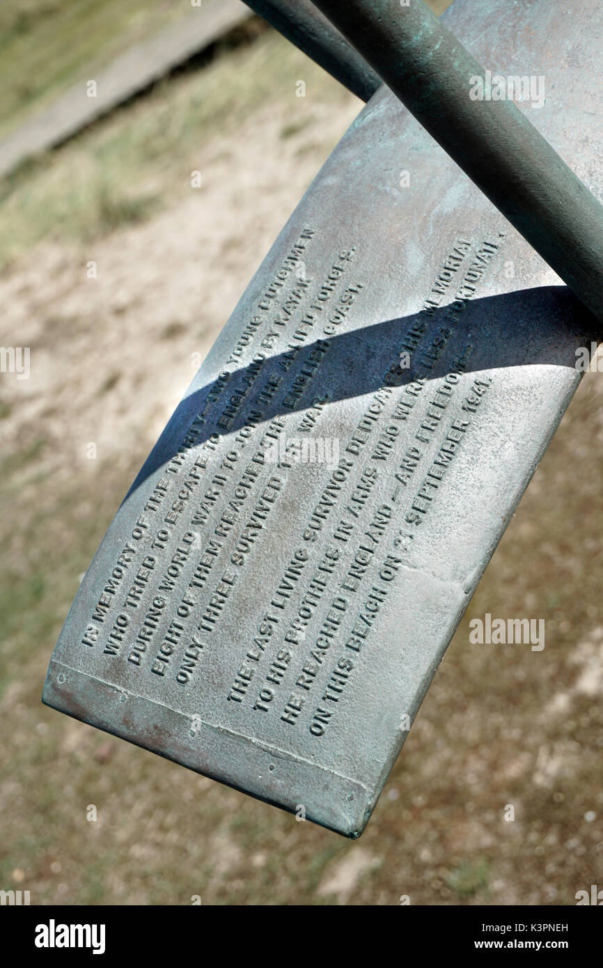 inscription on memorial at sizewell suffolk to dutchman who canoed across north sea  in world war 2 - Stock Image