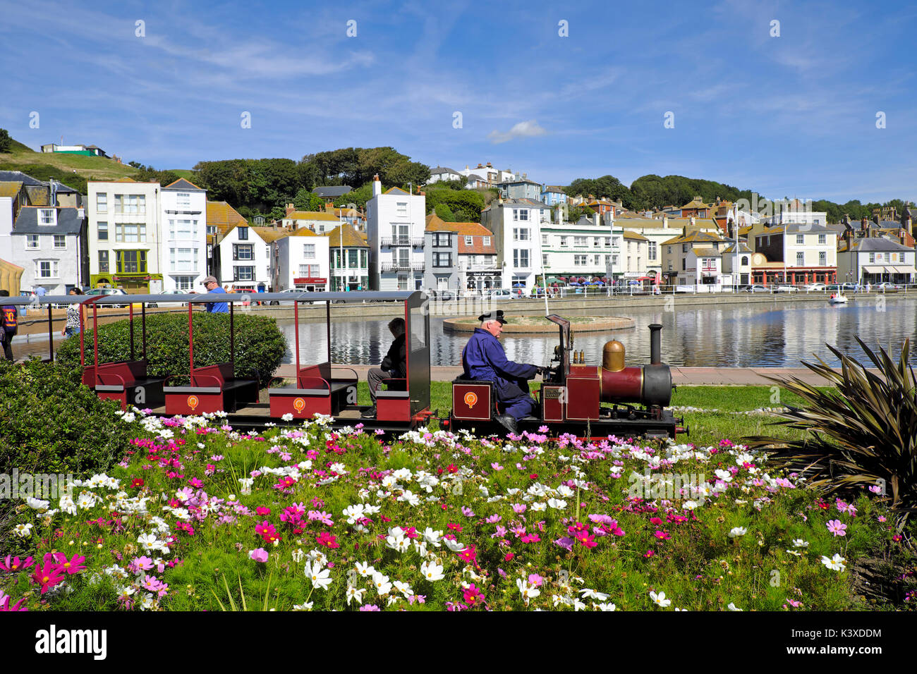 Hastings, UK. Miniature train on the seafront railway, on the promenade by the boating lake. Hastings Old Town seafront, - Stock Image