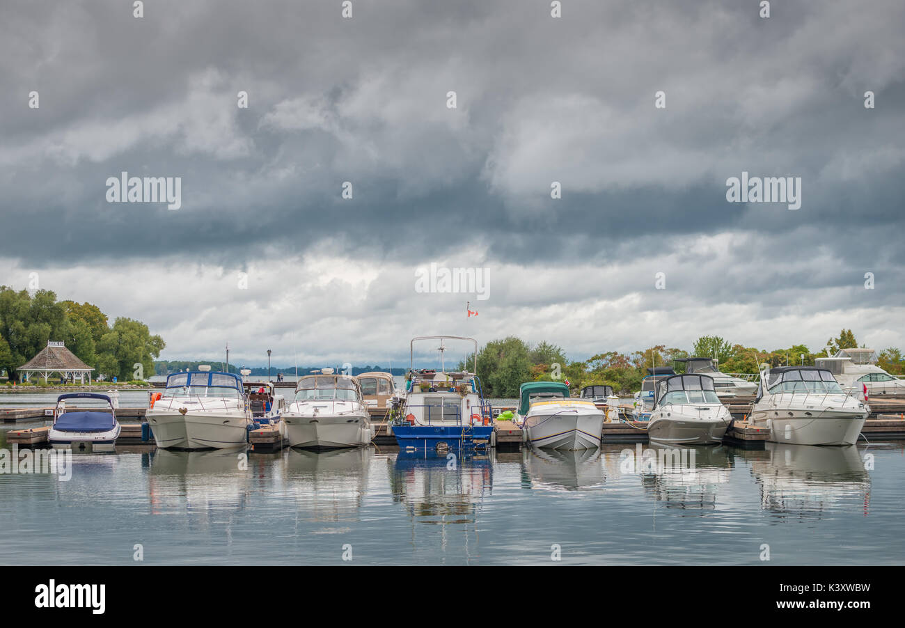 Small pleasure boats safely docked in the harbour at Orillia Ontario Canada as severe storms approch. Stock Photo