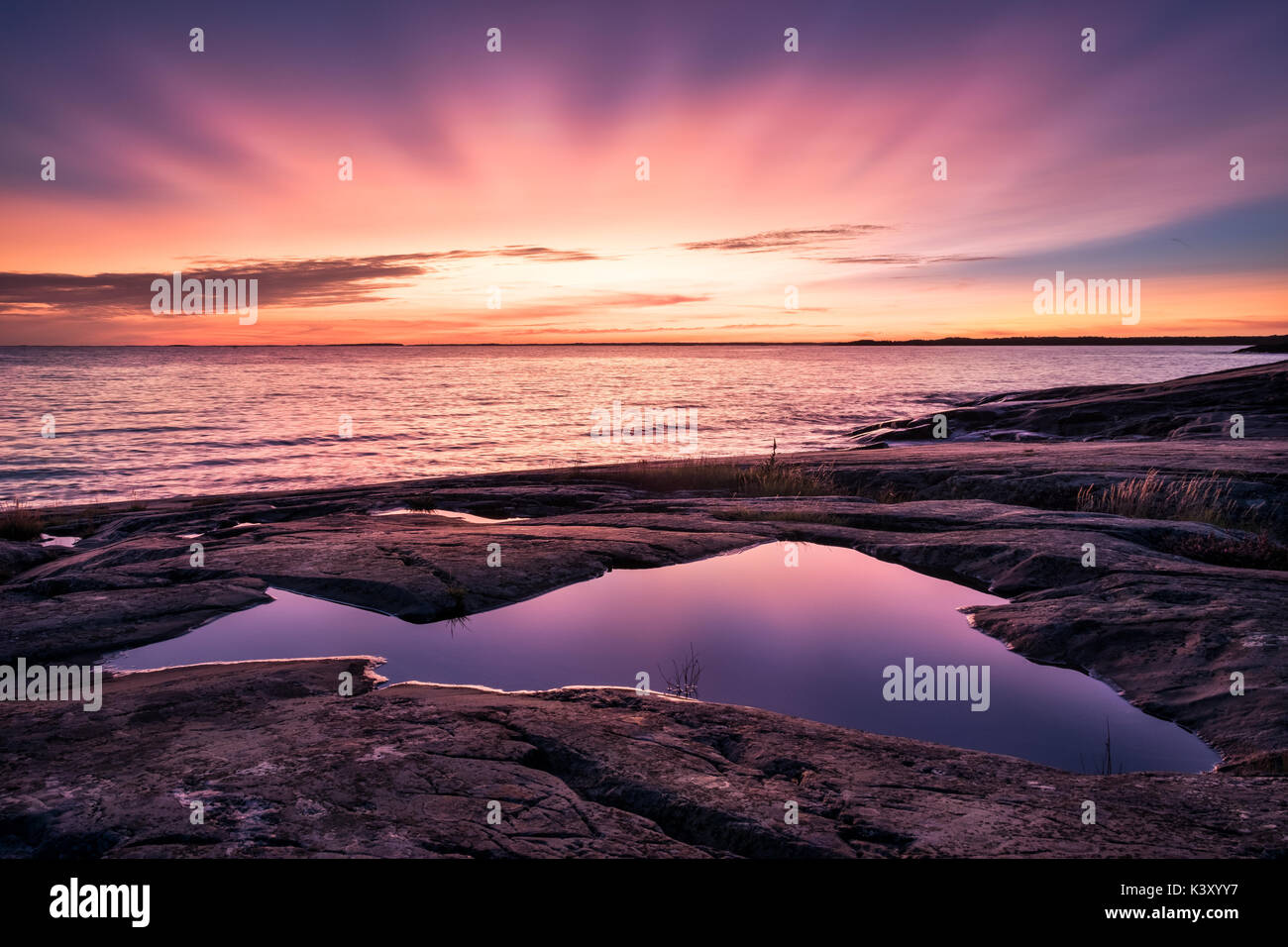 Epic sunset with beautiful color and sea at autumn evening in Porkkalanniemi, Finland - Stock Image