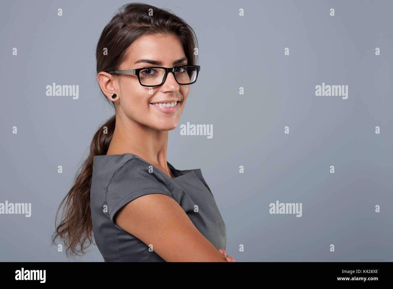 She's brimming of self confidence - Stock Image