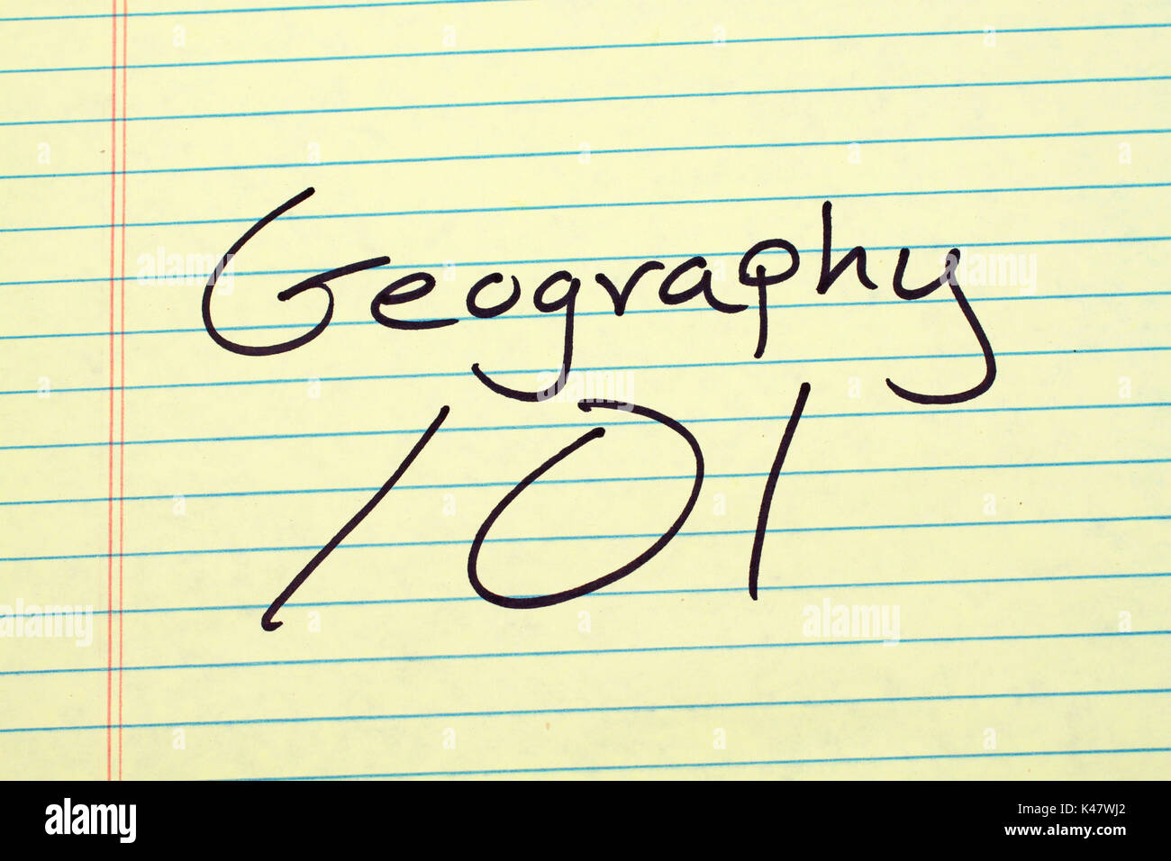 The words 'Geography 101' on a yellow legal pad - Stock Image