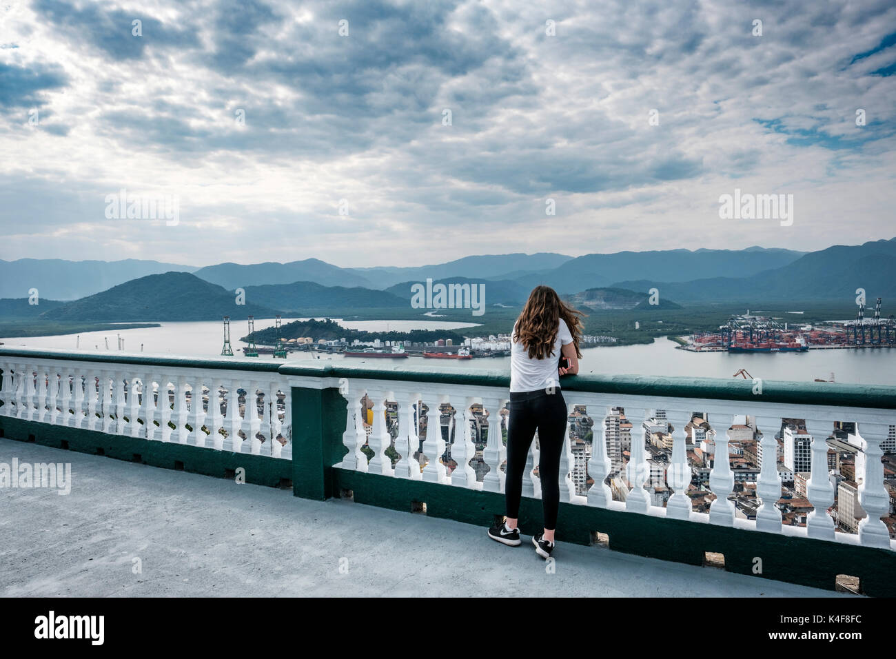 teenager-girl-appreciating-the-view-from-the-top-of-monte-serrat-overlooking-K4F8FC.jpg
