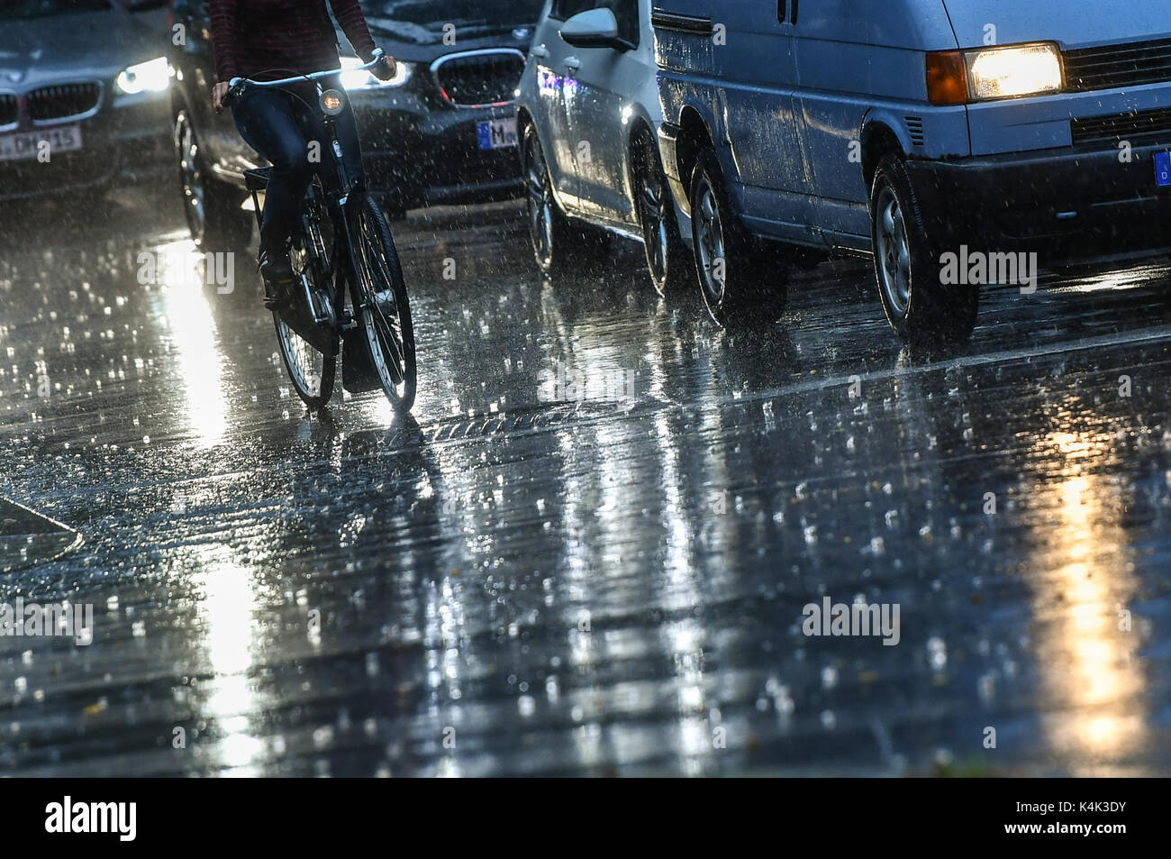 Heavy rain is falling the street Kantstrasse in Berlin, Germany, 06 September 2017. Photo: Jens Kalaene/dpa-Zentralbild/dpa - Stock Image