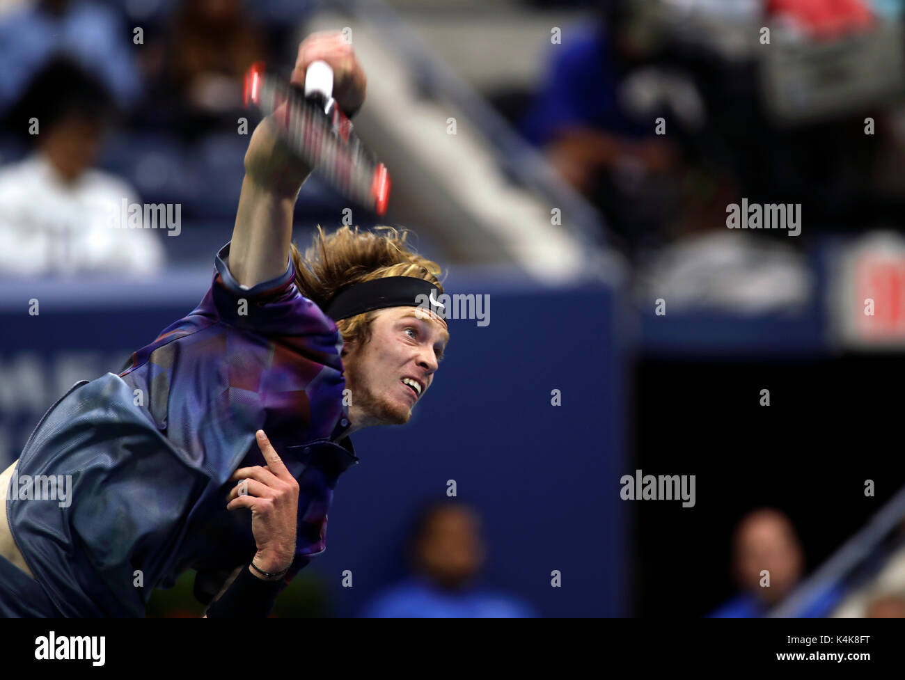 New York, United States. 06th Sep, 2017. US Open Tennis: New York, 6 September, 2017 - Andrey Rublev of Russia serves - Stock Image