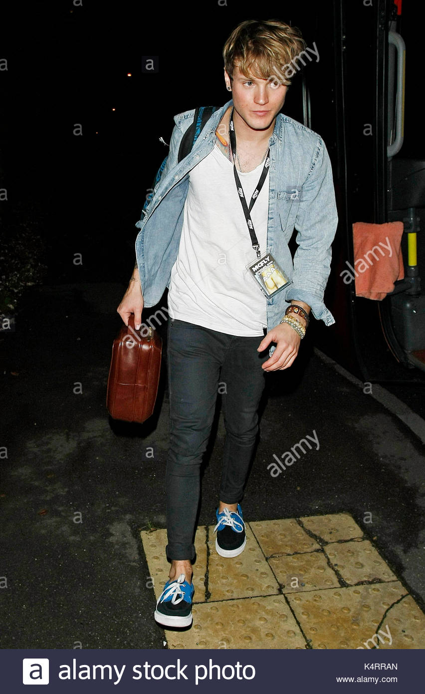 Dougie Poynter. Two of The Saturdays at The McFly gig in Hammersmith, London, England, UK. - Stock Image