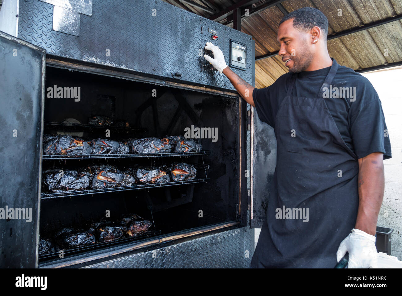 St. Saint Simons Island Georgia Southern Soul Barbeque restaurant BBQ outdoor smoker Black man cook cooked meat - Stock Image