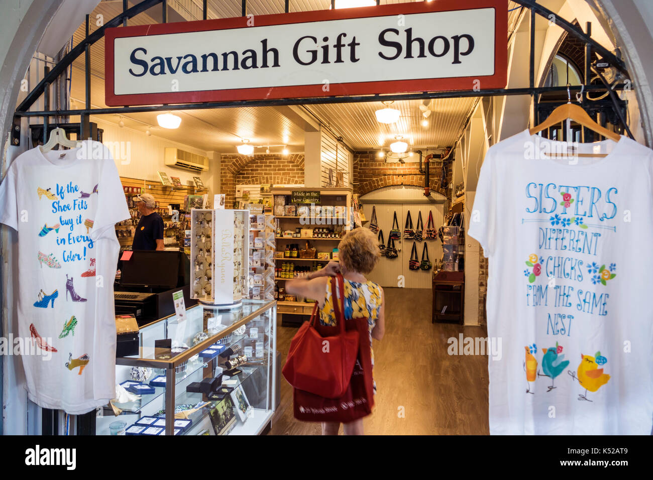 Savannah Georgia Visitors Information Center inside gift shop shopping tee t-shirt - Stock Image