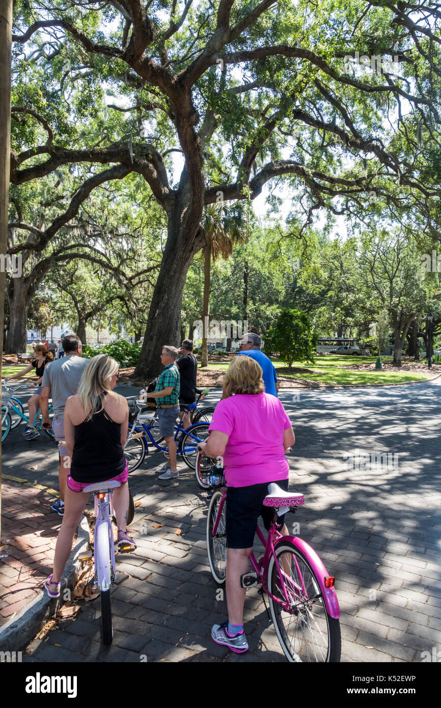 Savannah Georgia historic district Lafayette Square cyclist bicycle guided tour man woman - Stock Image