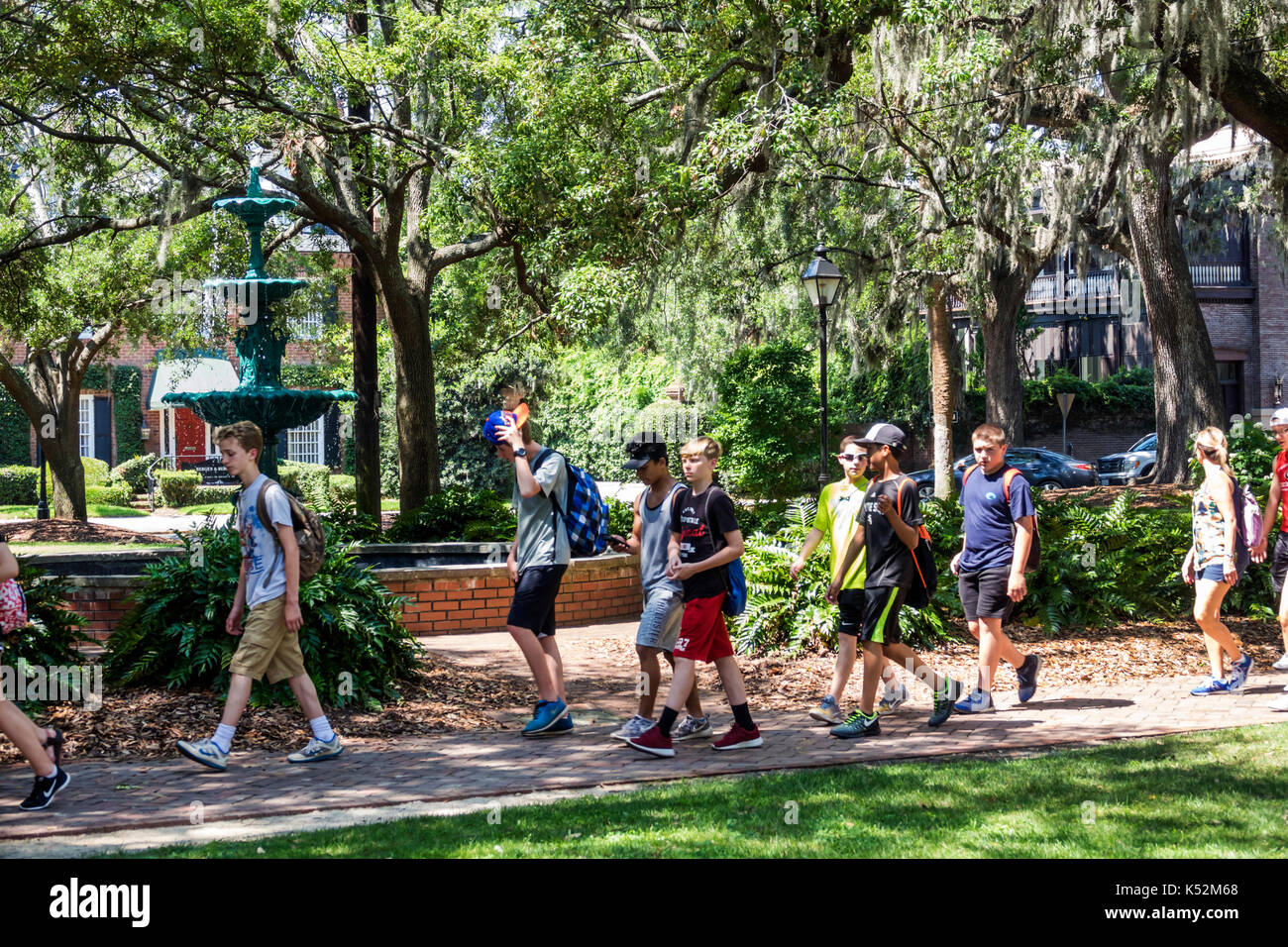 Savannah Georgia historic district Lafayette Square students walking park - Stock Image