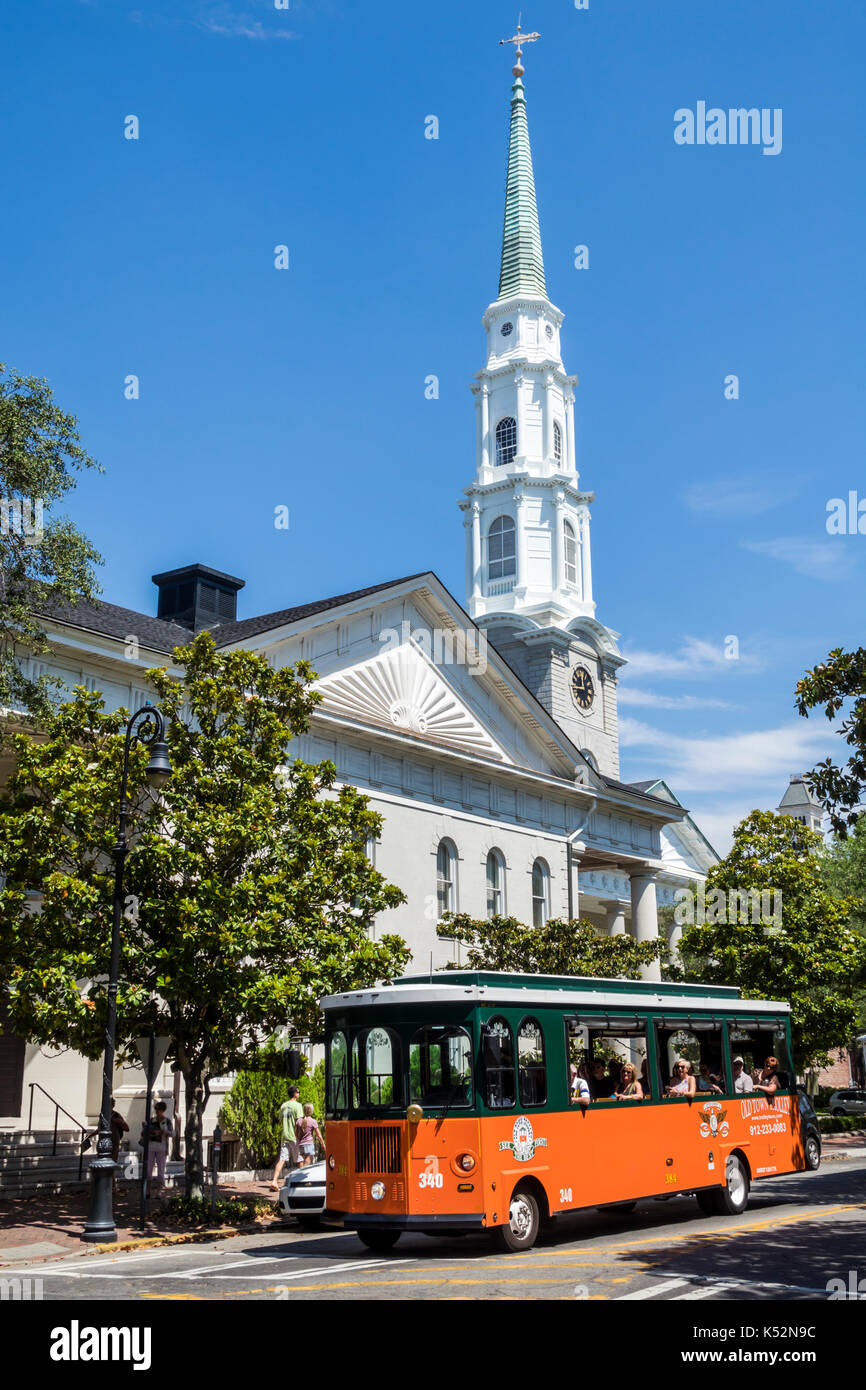 Savannah Georgia historic district Chippewa Square Independent Presbyterian Church steeple Old Town Trolley Tour - Stock Image