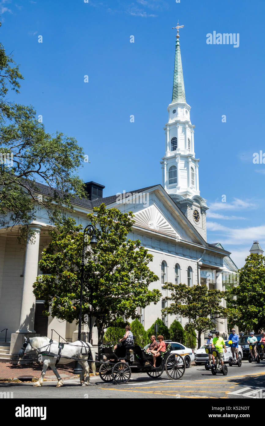 Savannah Georgia historic district Chippewa Square Independent Presbyterian Church steeple horse carriage Segway - Stock Image