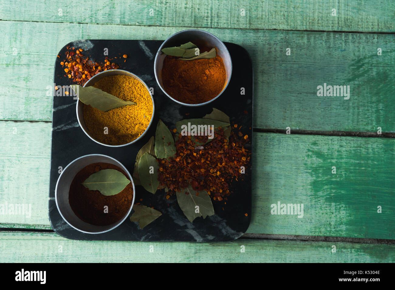 Close-up of various type spices on bowl - Stock Image