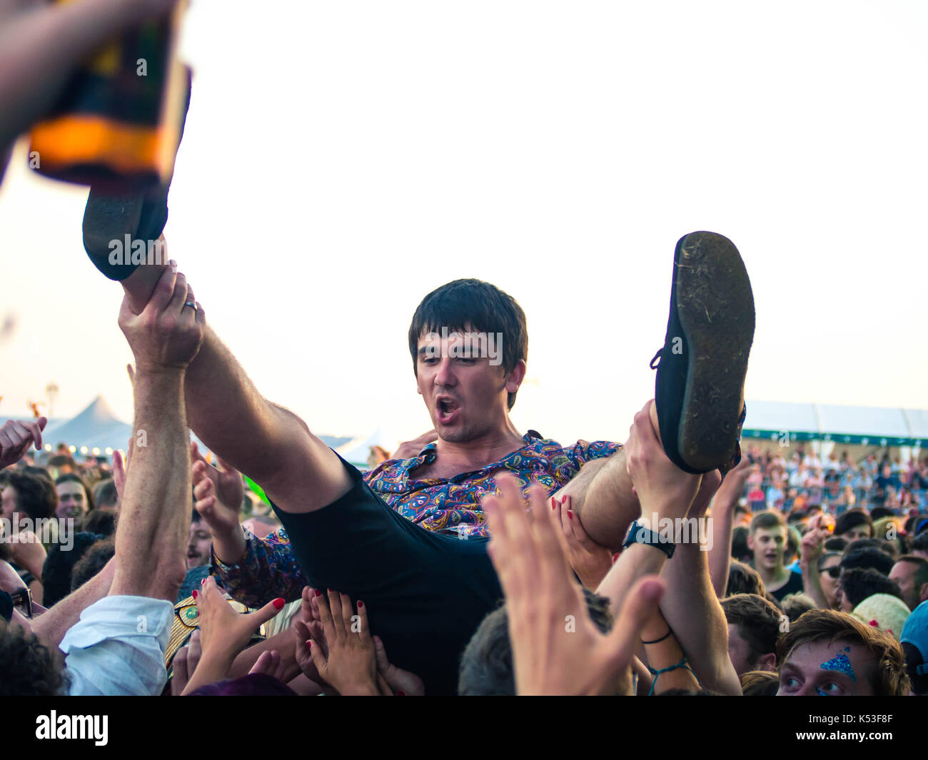 a-young-man-crowd-surfs-over-the-audience-at-the-victorious-music-K53F8F.jpg