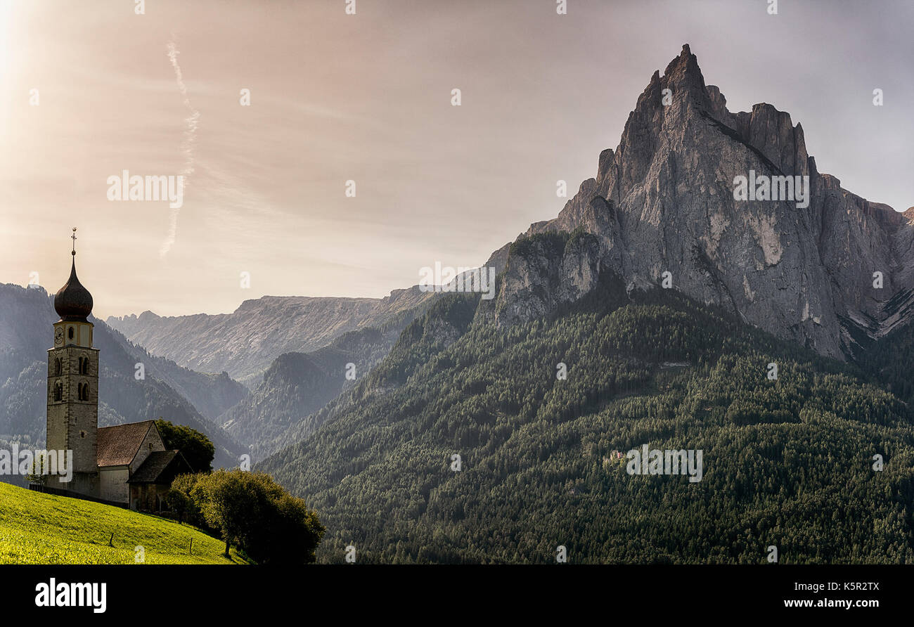 Church of St.Valentine in the morning with mountains in the background, Sudtirol - Italy - Stock Image