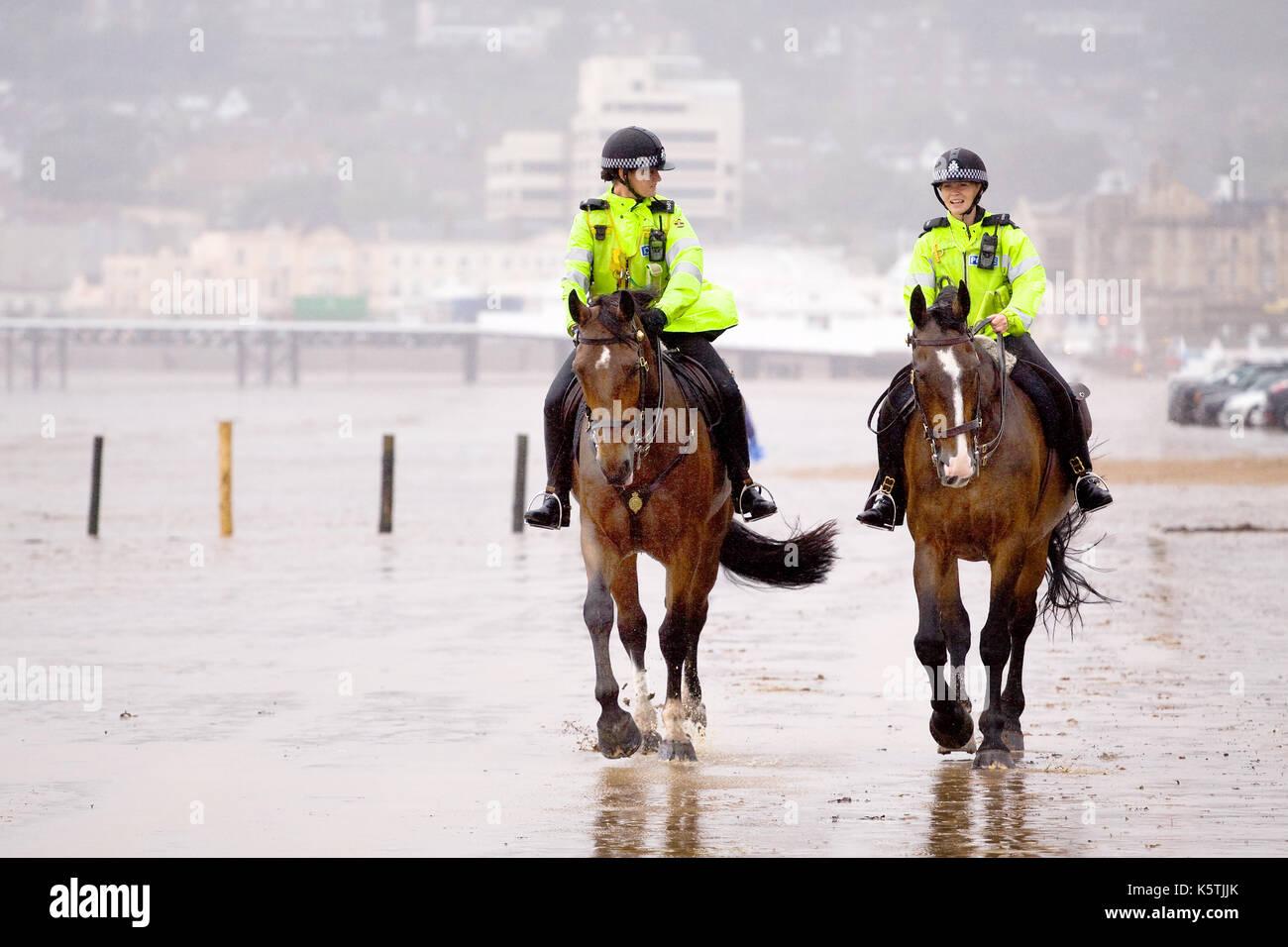 two-mouned-police-woman-on-patrol-in-flu