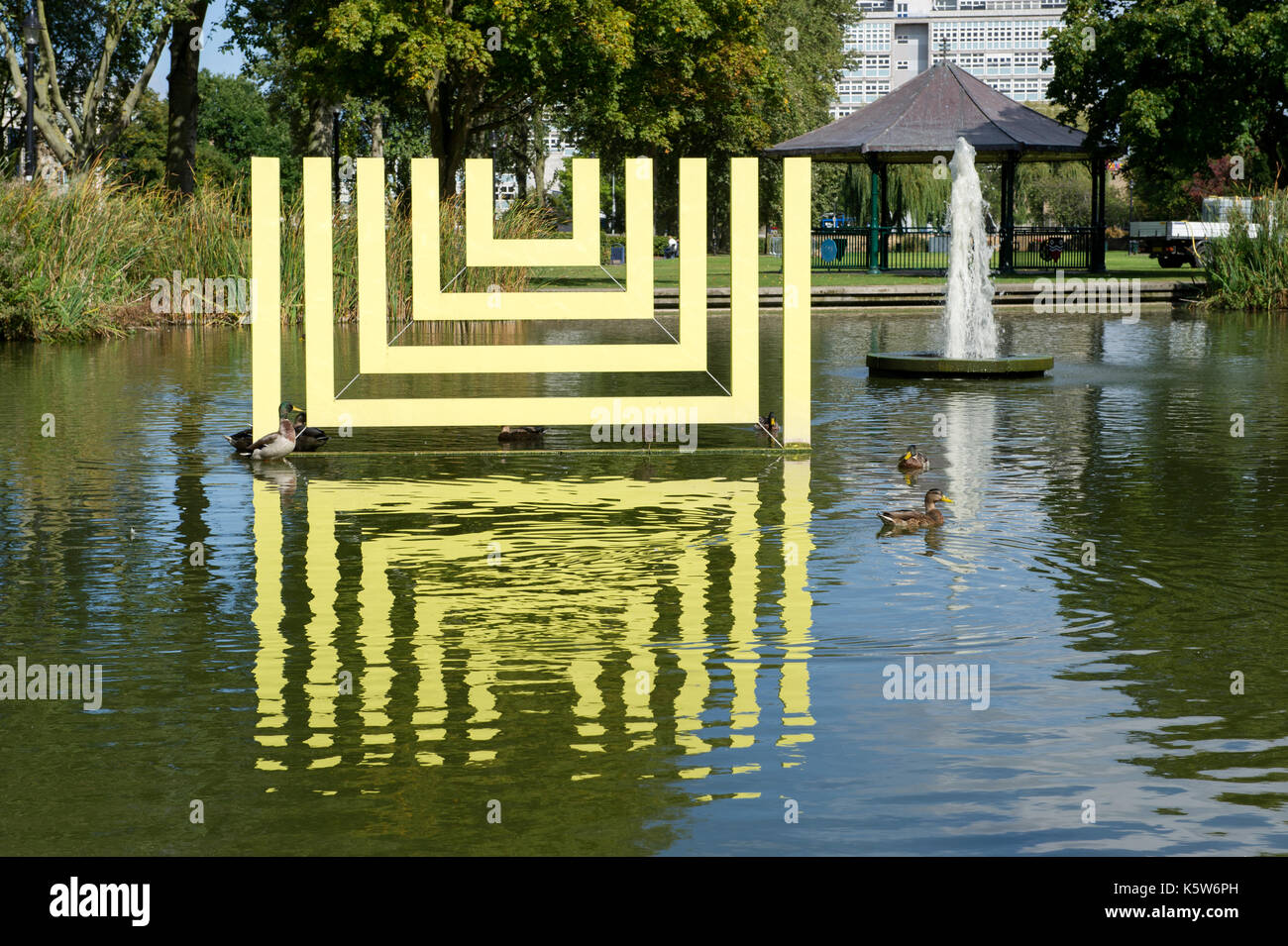The Kingston Upon Hull UK City Of Culture 2017 logo reflected in the ponds of Queens Gardens - Stock Image
