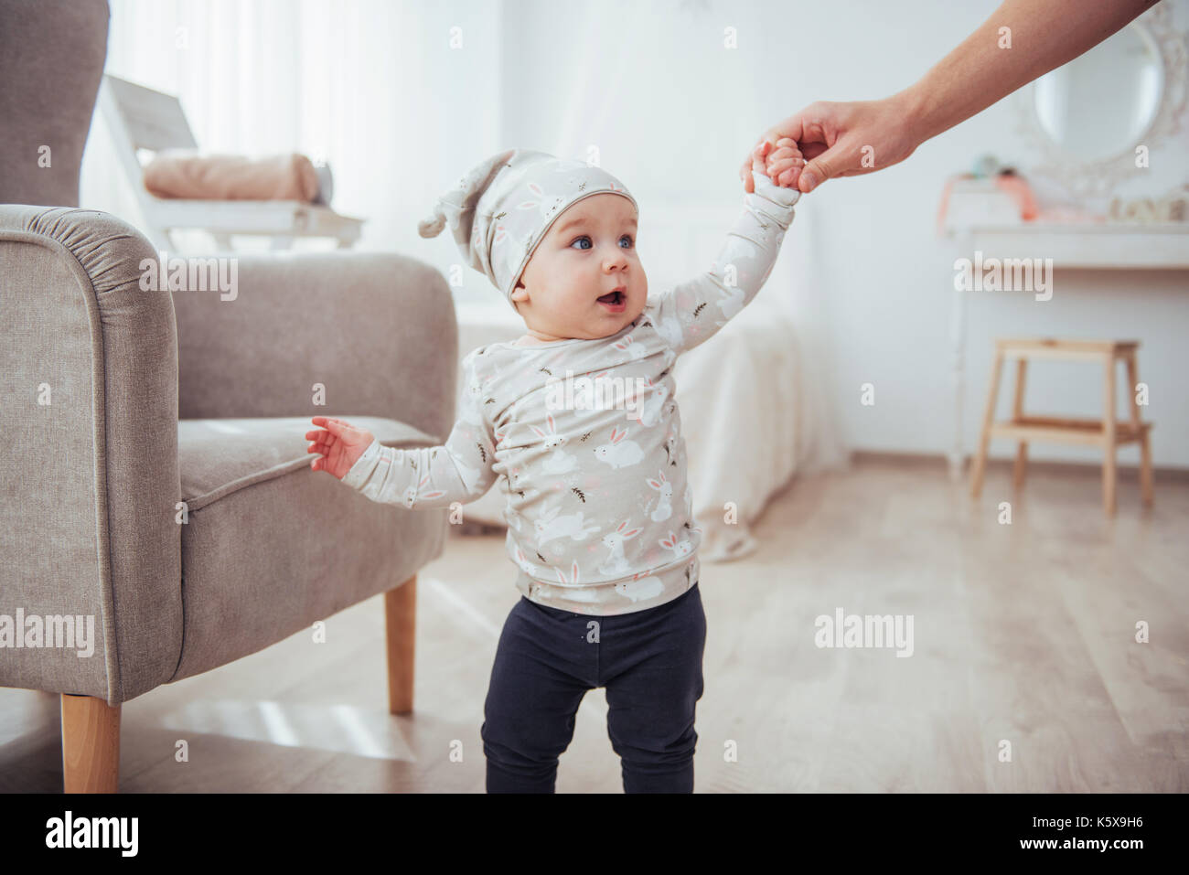 Happy baby chair next to a bright room - Stock Image
