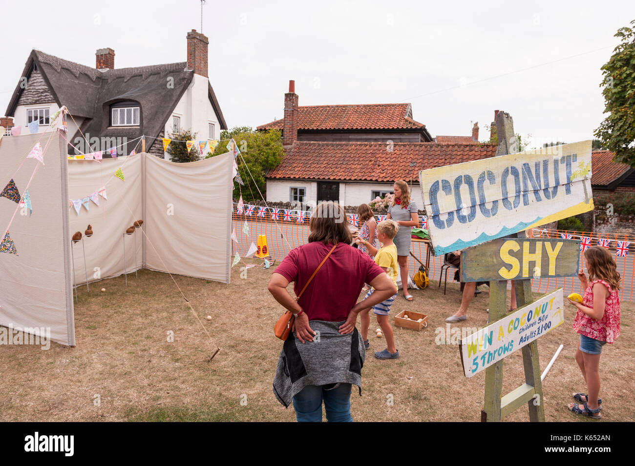 The Coconut shy at the village fete in Walberswick , Suffolk , England , Britain , Uk - Stock Image