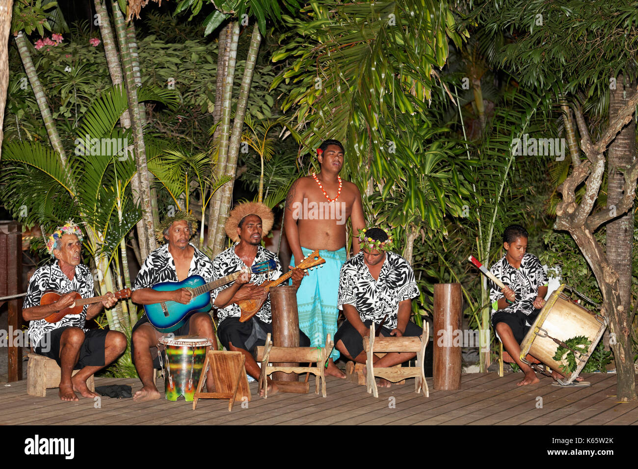 Traditional music band under palm trees, musicians, Bora Bora island, society islands, French Polynesia - Stock Image