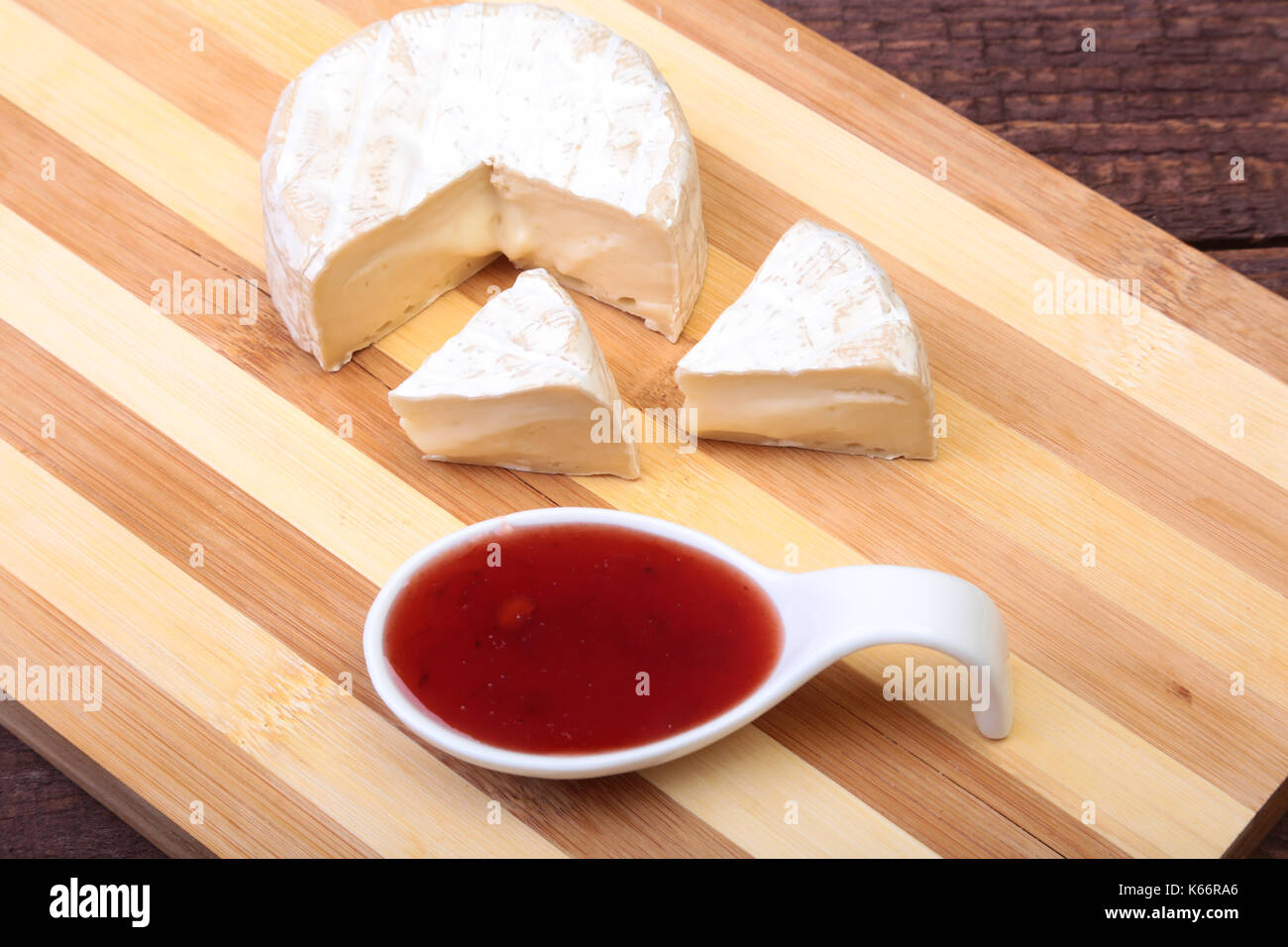 Cheese with white mold. Camembert or brie type with Cranberry sauce.. Healthy breakfast. - Stock Image