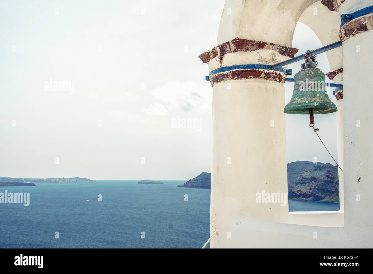Bell tower of an orthodox church at Santorini, Greece. Honeymoon summer aegean cycladic background. - Stock Image