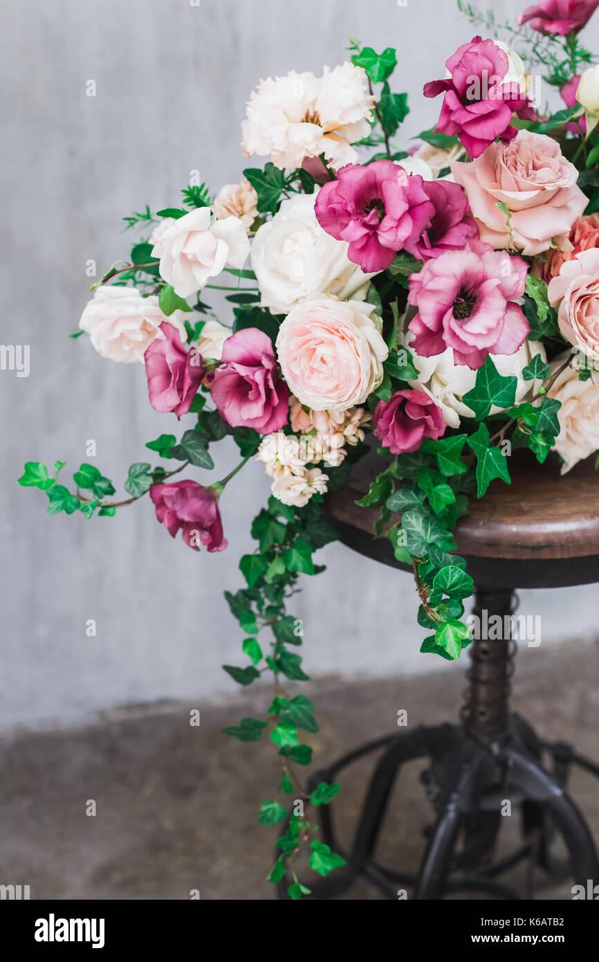 Wedding flower arrangement isolated on grey textured background - Stock Image