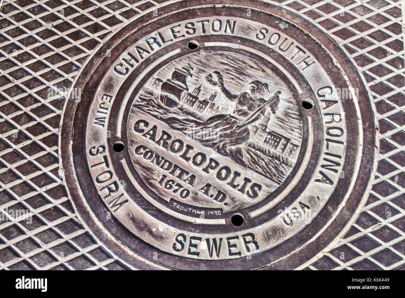 Charleston South Carolina SC Historic Downtown manhole cover sewer Carolopolis plate - Stock Image